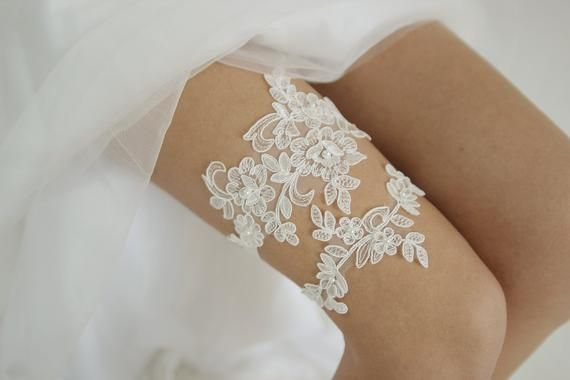 Lace & Pearls - ivory lace wedding garter set, Pearl garter set, floral lace garter, lace wedding garter, style G06 Lace & Pearls garter set was made from beautiful lace that was hand adorned with pearl beads and sewn to the elastic. ♥ The lace is sewn to 5/8 inch elastic. The garter has elastic at the back. ♥ Please choose when checking out whether you would like to purchase 1 garter (main/keepsake garter only) or 2 garters (garter set that consists of main/keepsake garter and toss garter)♥ 3''