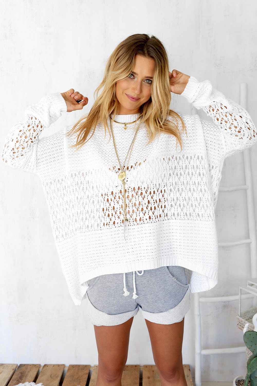 Stay warm with the Tamia White Knit, featuring a high neckline, a ...