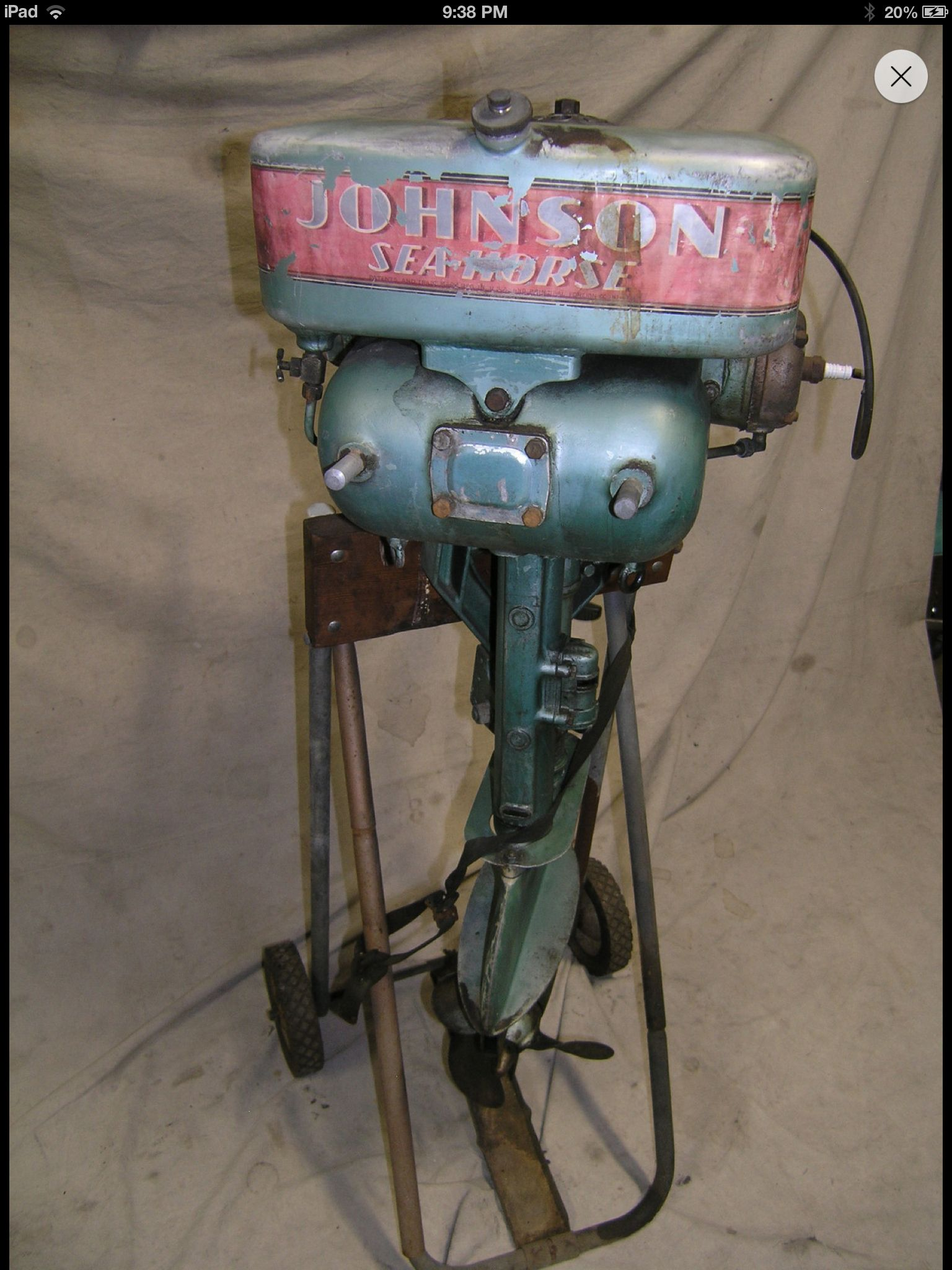 Johnson outboard motor. My son has one of these in his room. He says it's a PO-15 22hp from the 40's.