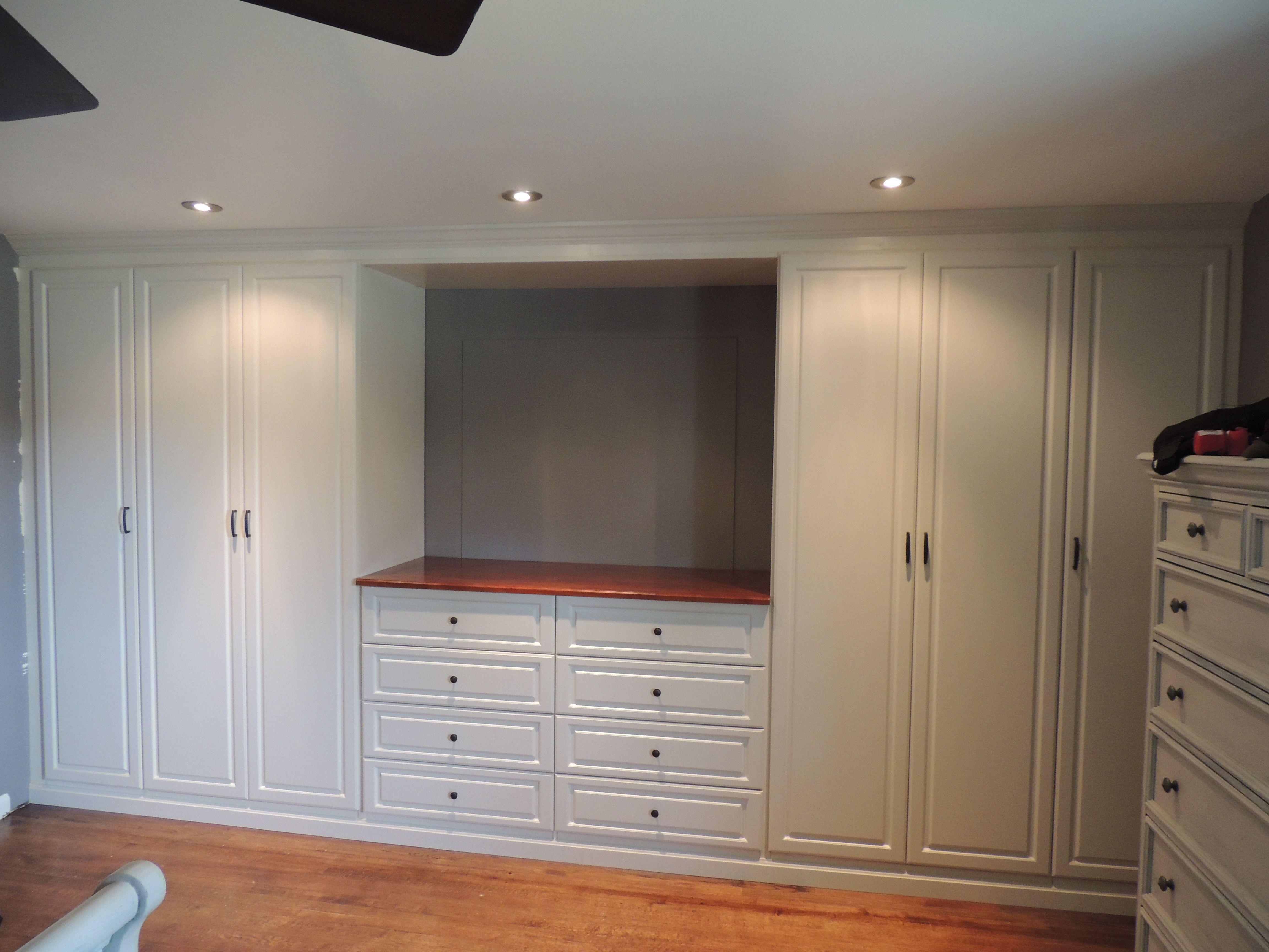 Custom White Wall Unit In A Master Bedroom Wardrobes Bedroom Bedroom Wall Units Build A Closet Bedroom Built Ins