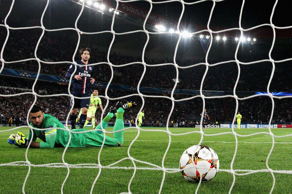 Goalkeeper, Salvatore Sirigu of PSG looks at the ball in the net after Lionel Messi (not in frame) of Barcelona scores during the Group F UEFA Champions League match between Paris Saint-Germain v FC Barcelona held at Parc des Princes on September 30, 2014 in Paris, France.