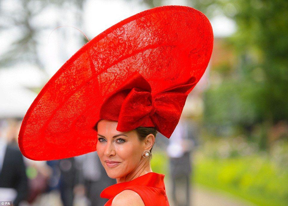 Spectacular: Racegoer Belinda Stradwick shows off her incredible crimson lace hat, topped ...