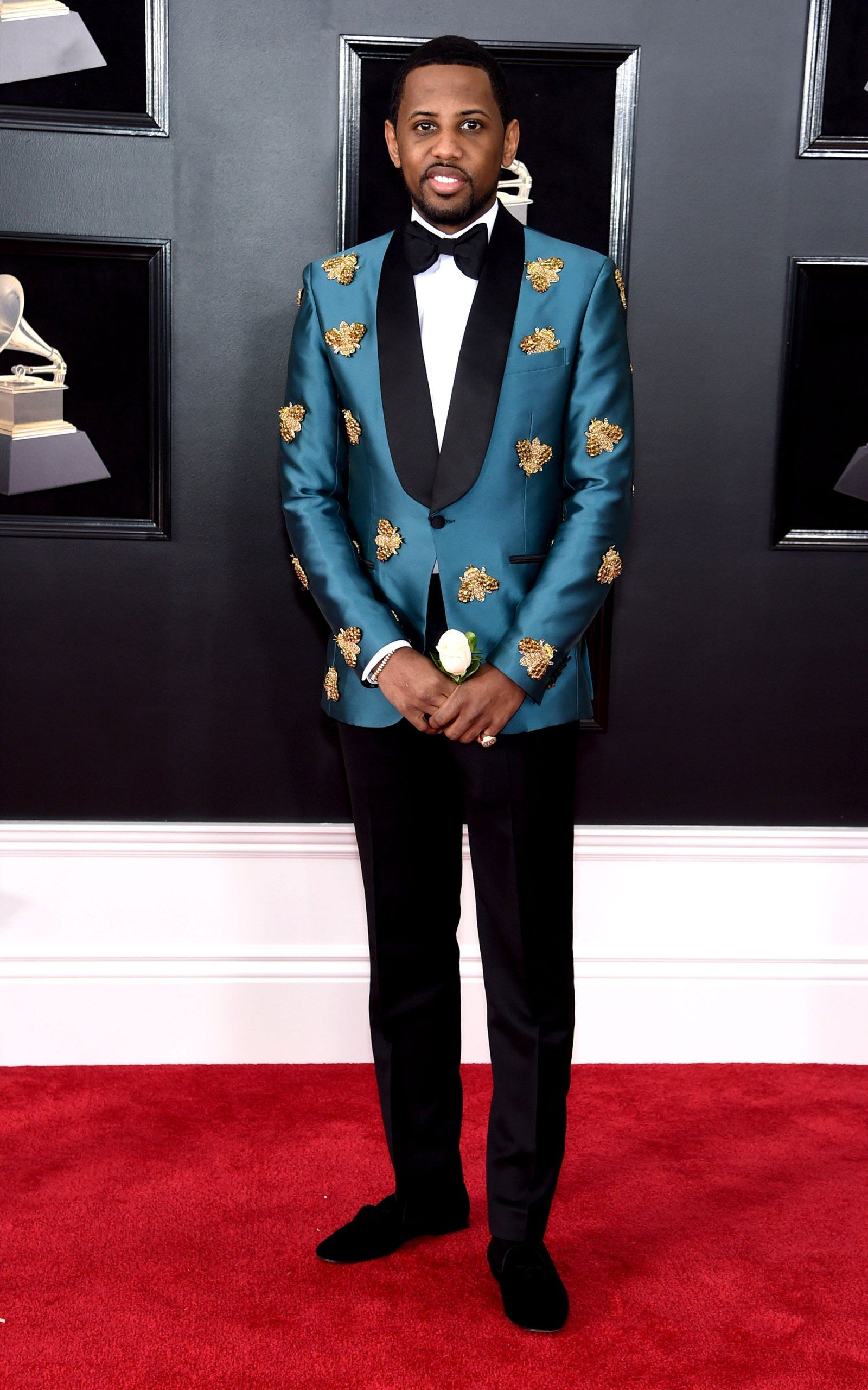 Photo of Fabolous in the 2018 Grammy Awards. This suit shows dandy fashion  because of the bold color and detailed beading on the jacket. e6a27522f4