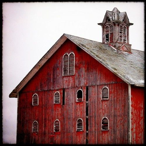 I love the gorgeous, rich red of this barn, especially with the gray roof.  :)