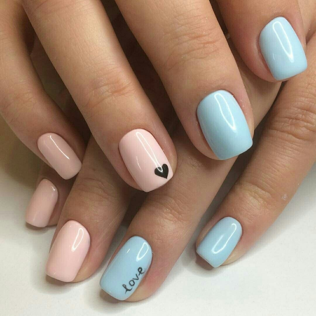 Pink nails with black heart and blue nails with love