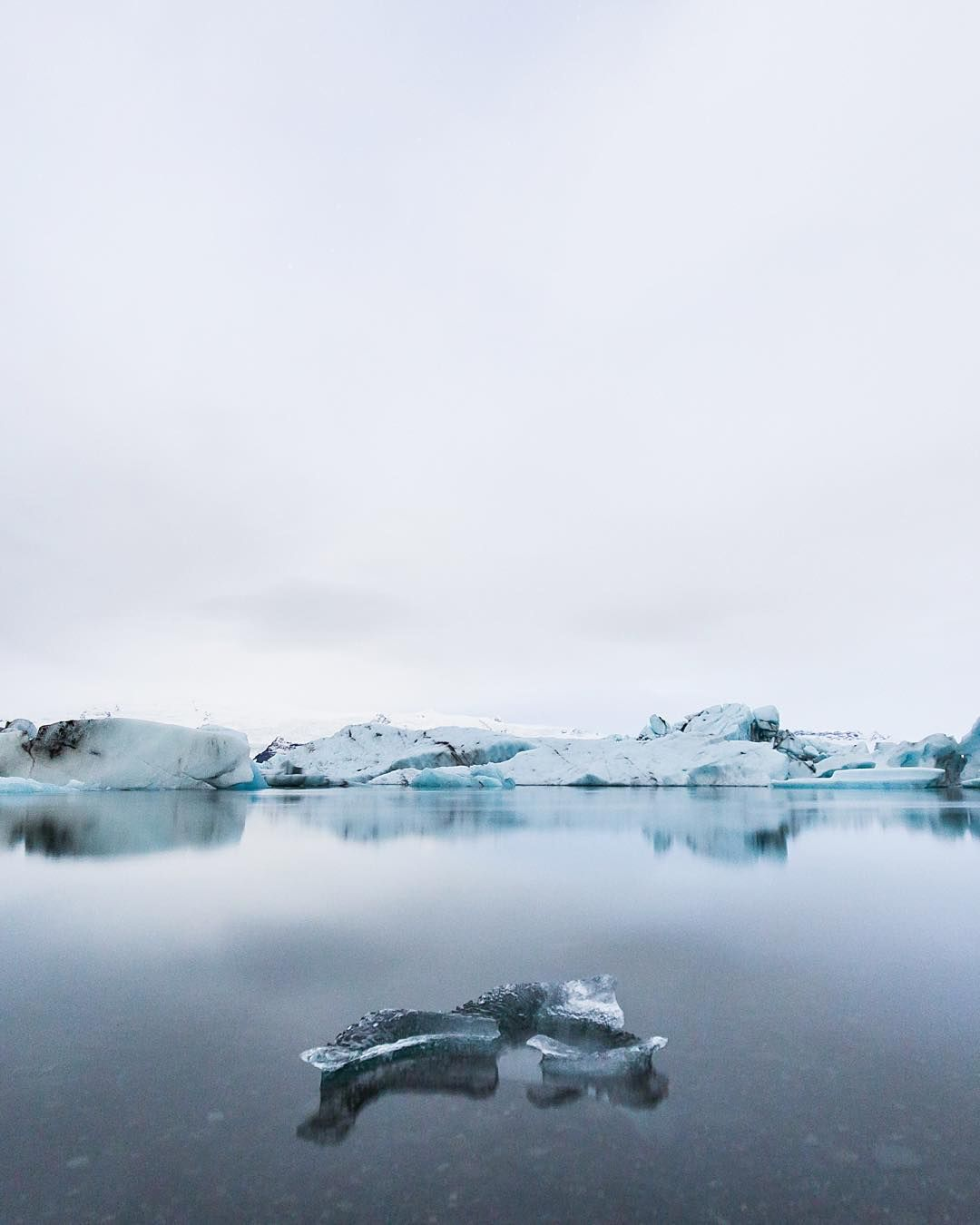 Glowing ice in the midnight light.  We had a real cool meet up here in Reykjavík this afternoon the @instagram community is truly rad and it's great to see so many bright minds come together for photography.  Heading south tomorrow with some awesome NY folk stay tuned for shenanigans  by benjaminhardman