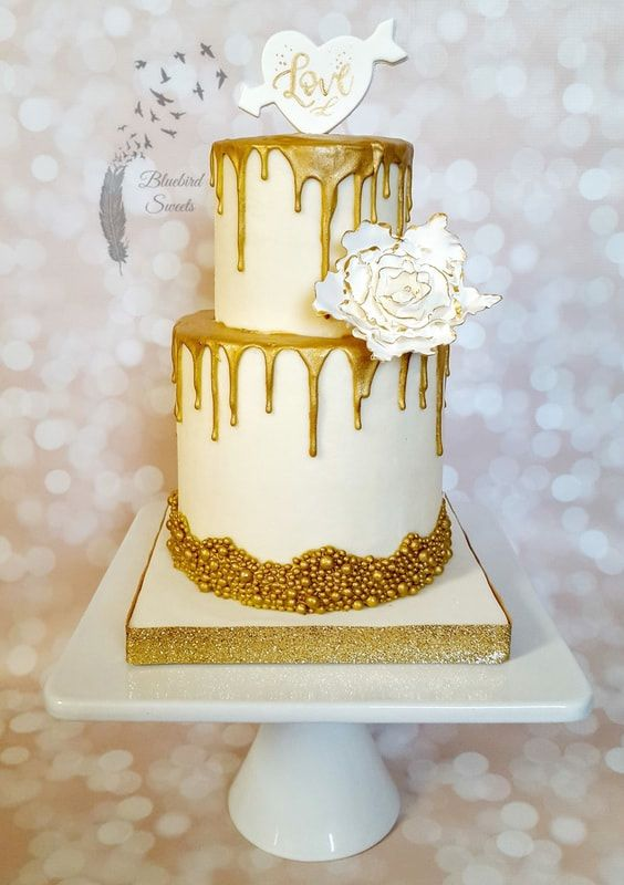 gold drip wedding cake with white and gold fantasy flower | Eye ...