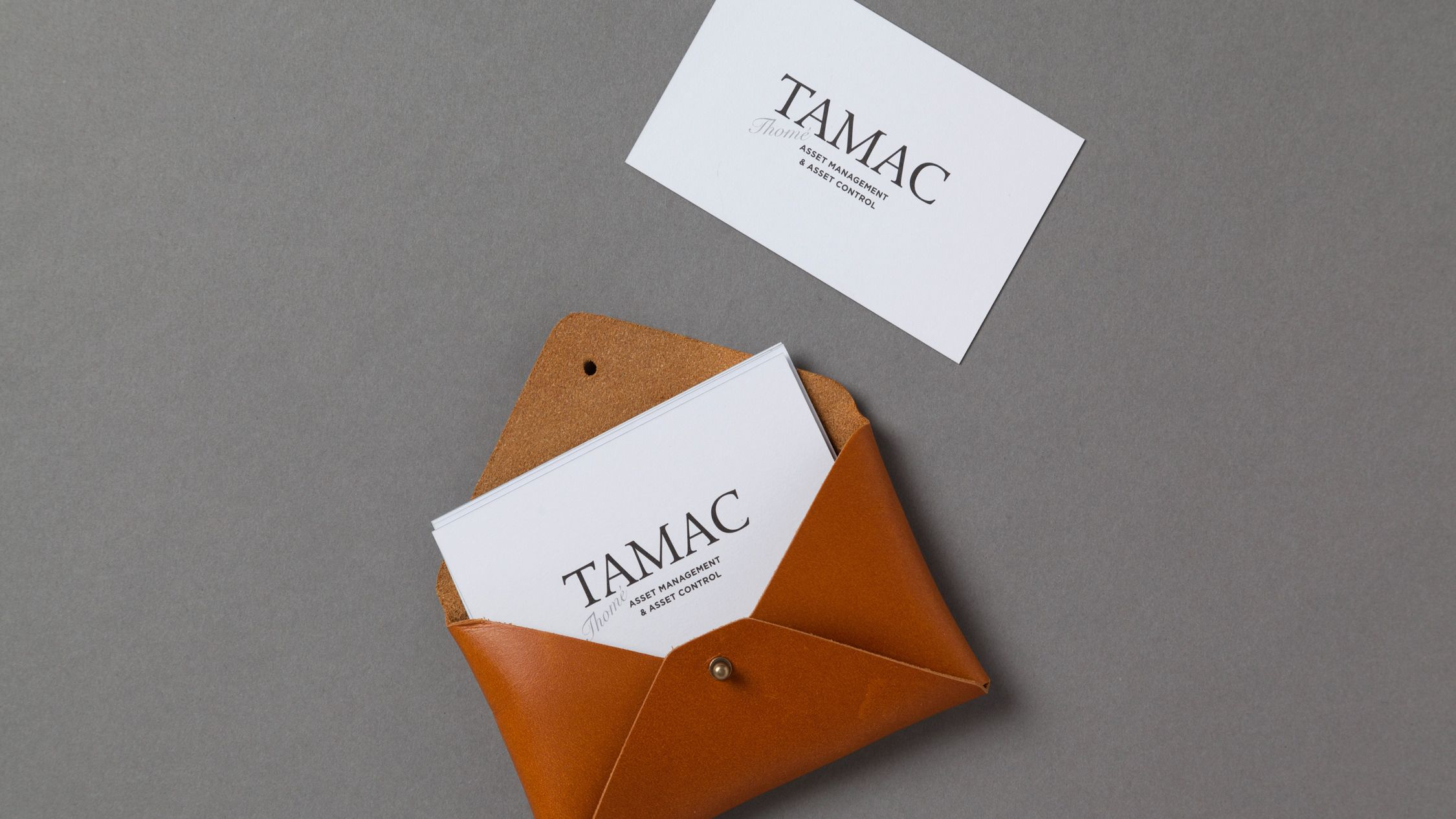 logo and identity for tamac a british investment firm by