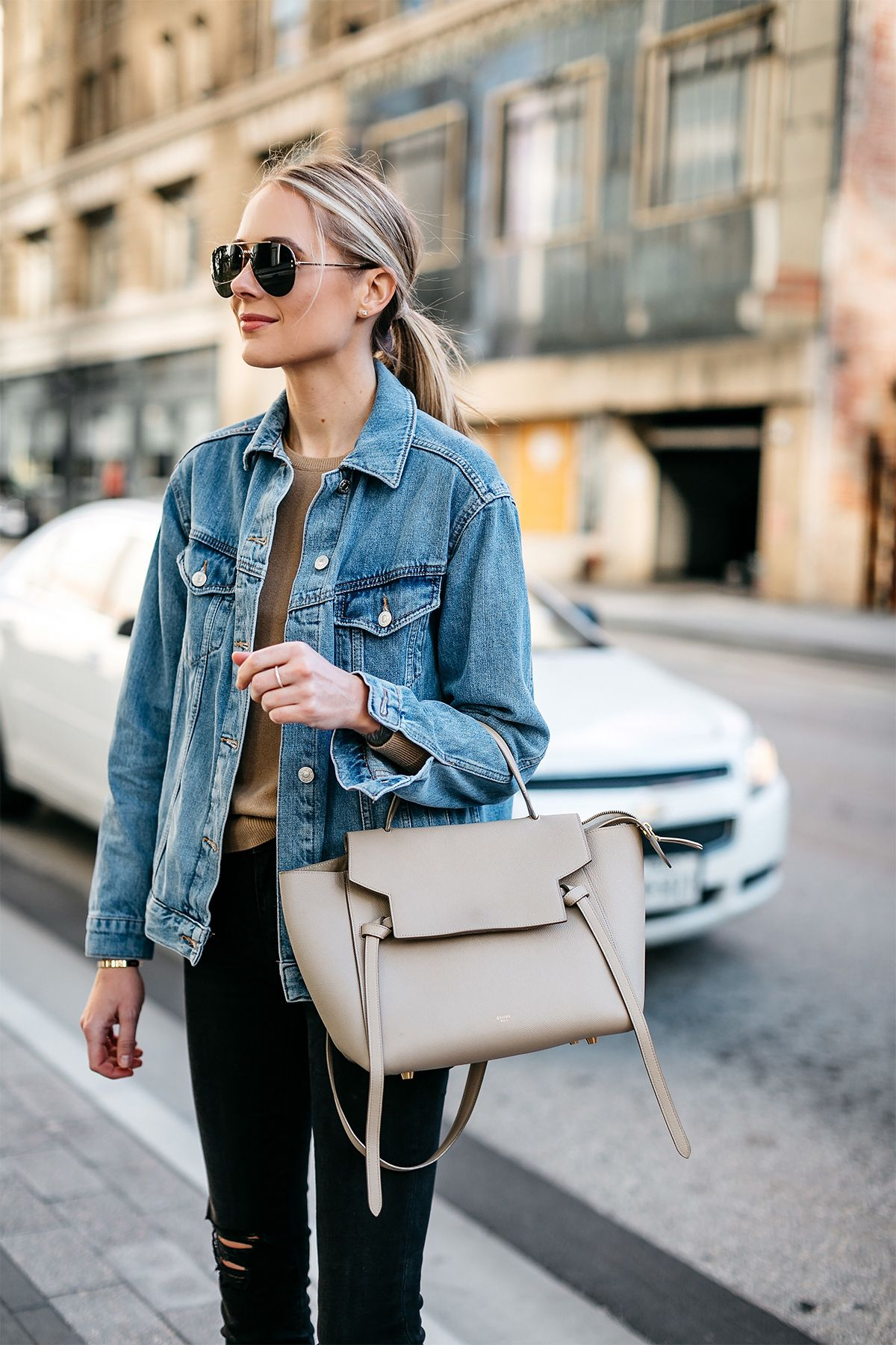 474fada368f46 Blonde Woman Wearing Topshop Oversized Denim Jacket Tan Sweater Black  Ripped Skinny Jeans Celine Mini Belt Bag Celine Aviator Sunglasses Fashion  Jackson ...