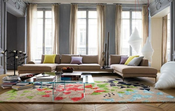 wohnzimmer einrichten beispiele farbiges teppichmuster bücher - wohnzimmer design beispiele