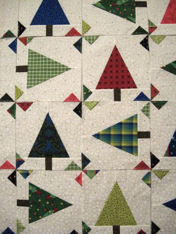 Free Quilt Patterns Christmas Tree : Christmas trees and prairie point pinwheels. Love. Free pattern at Hancock of Paducah. Search ...