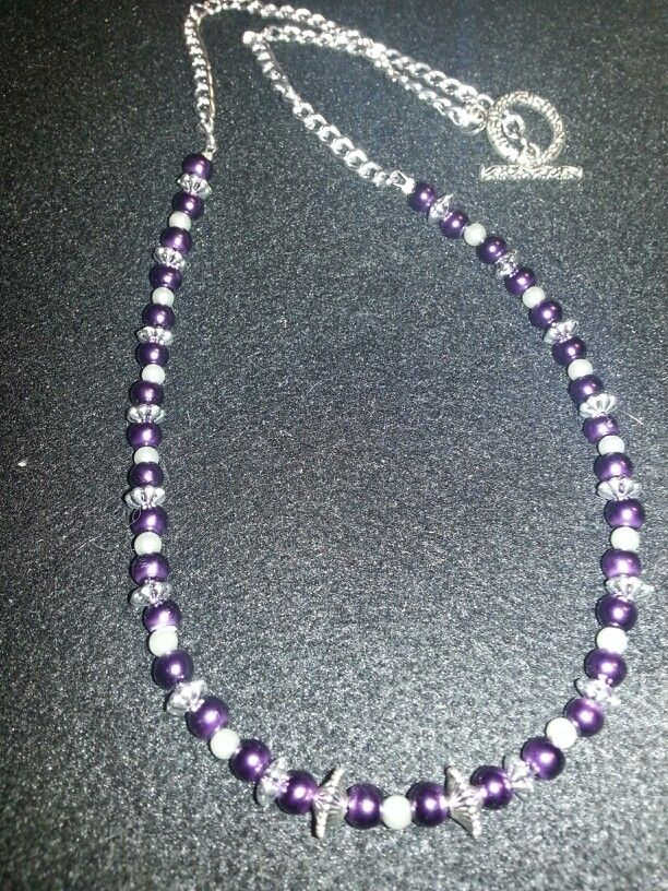 Deep purple pearl necklace with silver accents and toggle clasp