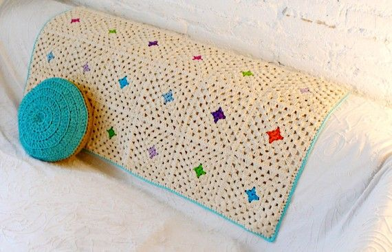 delicate use of colour in a simple granny square crochet blanket