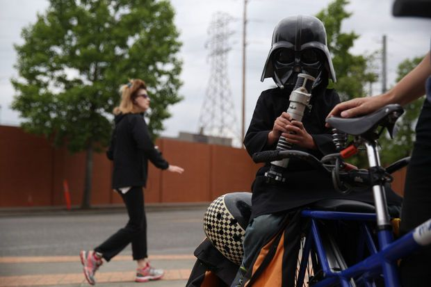 PORTLAND, OREGON - June 12, 2014 - Dozens of intergalactic cyclists turned out for the fifth annual Star Wars vs. Star Trek bike ride - part of Pedalpalooza.      Faith Cathcart/The Oregonian