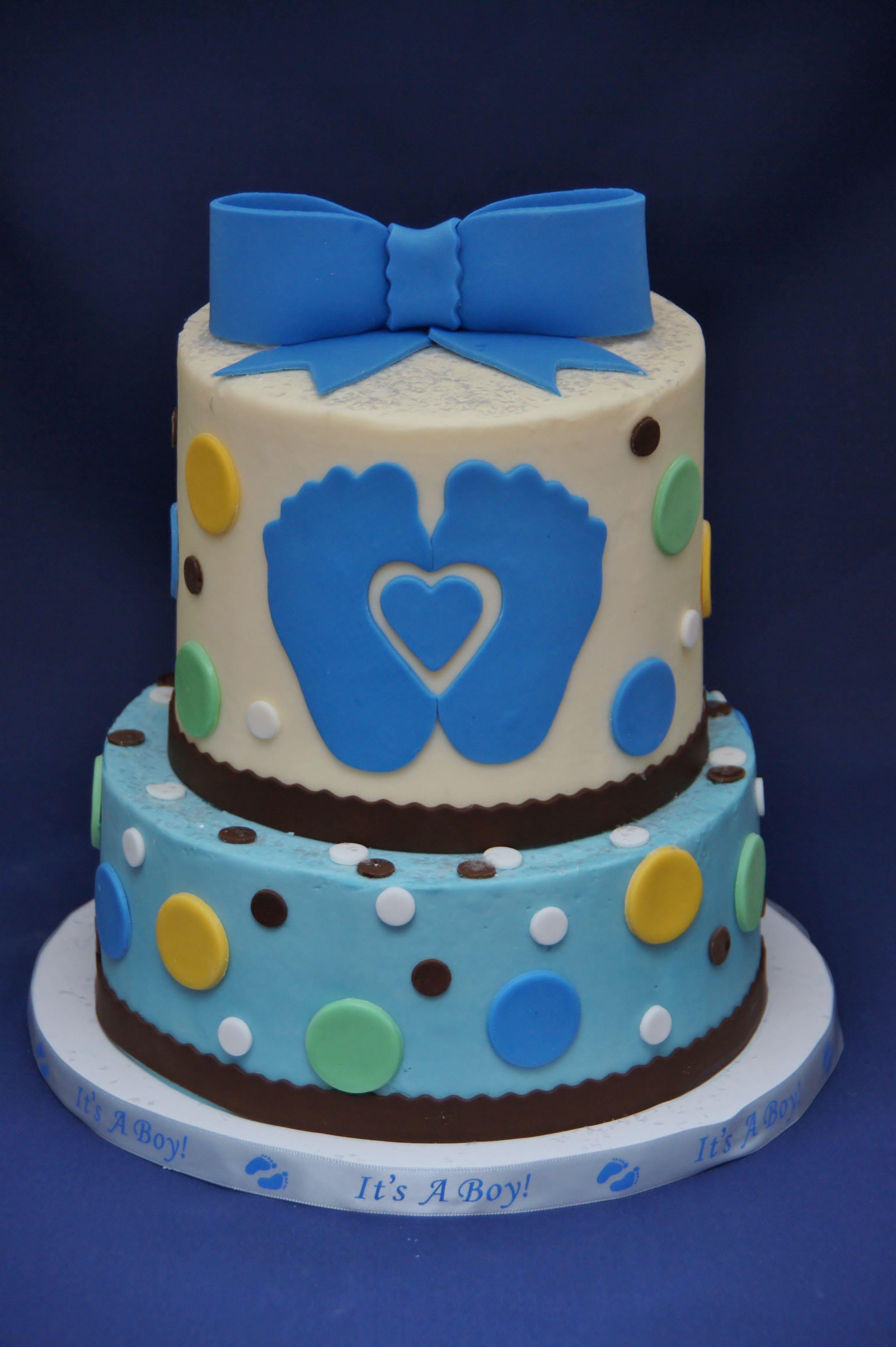 Polka dots and footprints baby shower cake