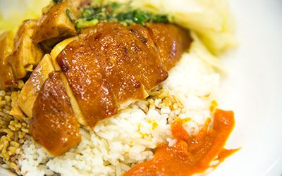 """Well, if it isn't everyone's favorite """"Siu mei"""" rice! Otherwise known as 'Soya Chicken,' this dish was near perfect. UniRice has concluded that S.H. Ho is the best place to order BBQ meat."""