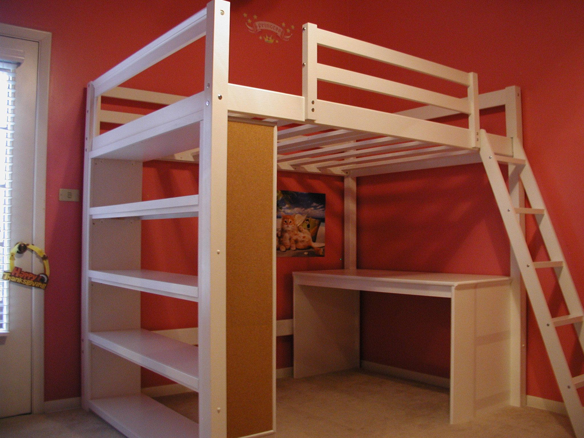 Full size white wood loft bed with long tall shelves and