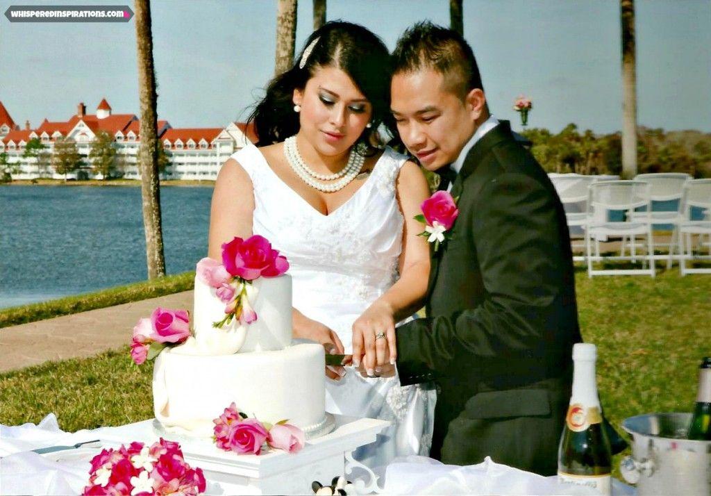 Cutting our cake. It was beautiful and unforgettable. And #Disney made it happen.  #DisneyWedding #weddingcake #roses #Stephanotis #hiddenmickey #love #marriage #PolynesianResort #weddingpearls #bridalcomb #tuxedo #boutonniere