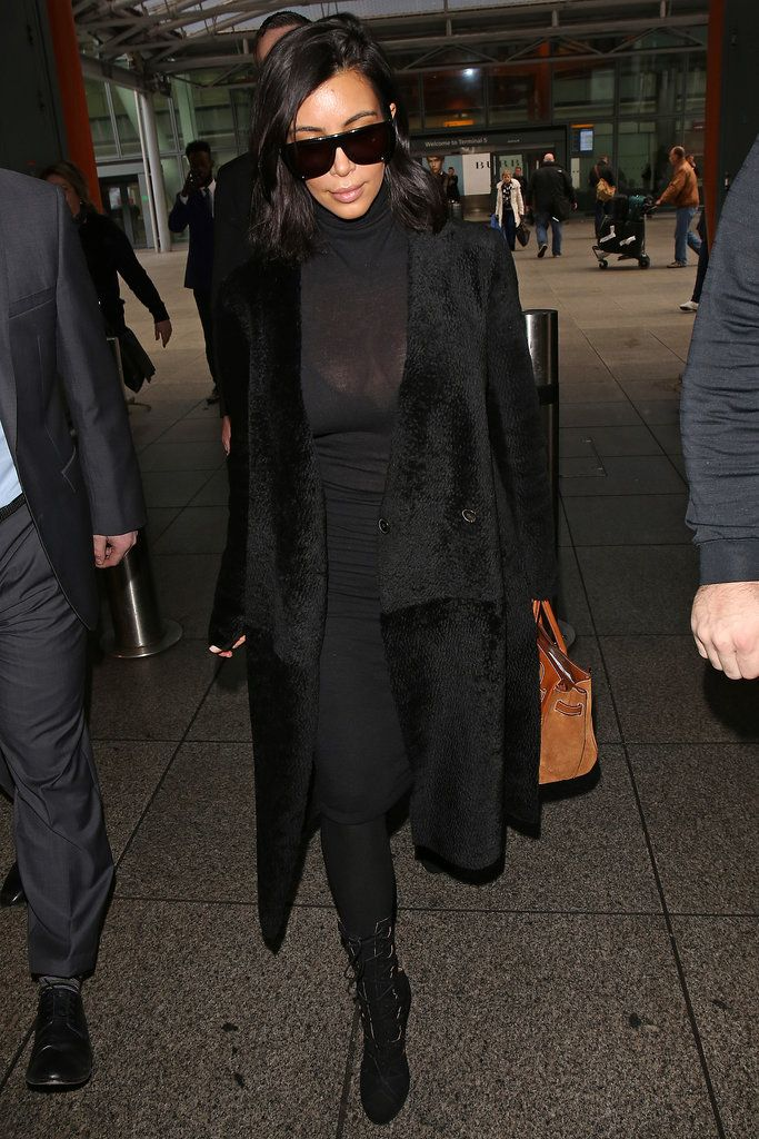 """Even Covered-Up Kim Can't Help but Show Off Her Body: For most people, wearing a turtleneck is a modest fashion choice: the Winter wardrobe staple was made for warmth and isn't exactly considered """"sexy."""""""