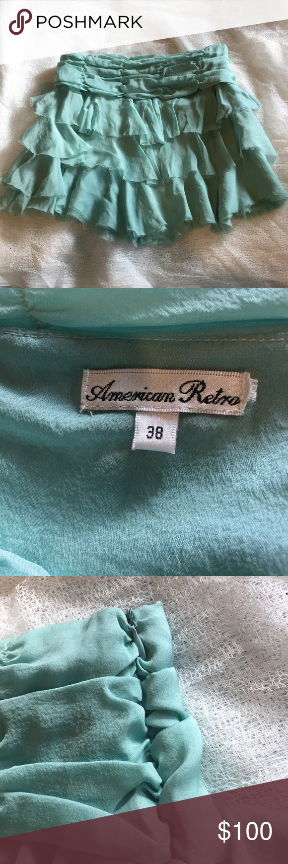 "RARE America Retro Silk Tiered Skirt Très chic! Super rare American Retro seafoam aqua skirt is 100% silk. Features a ruched waistband, three tiers of beautiful unfinished-hem ruffles, & a tonal side zipper. Bottom tier is two layers (see pic). American Retro was an über chic French brand. French size 38 translates to American size 4 or 6. Skirt is 31.75"" around at the waistband and approximately 15"" at center front. There are a couple small spots on the waistband that can't be captured in…"
