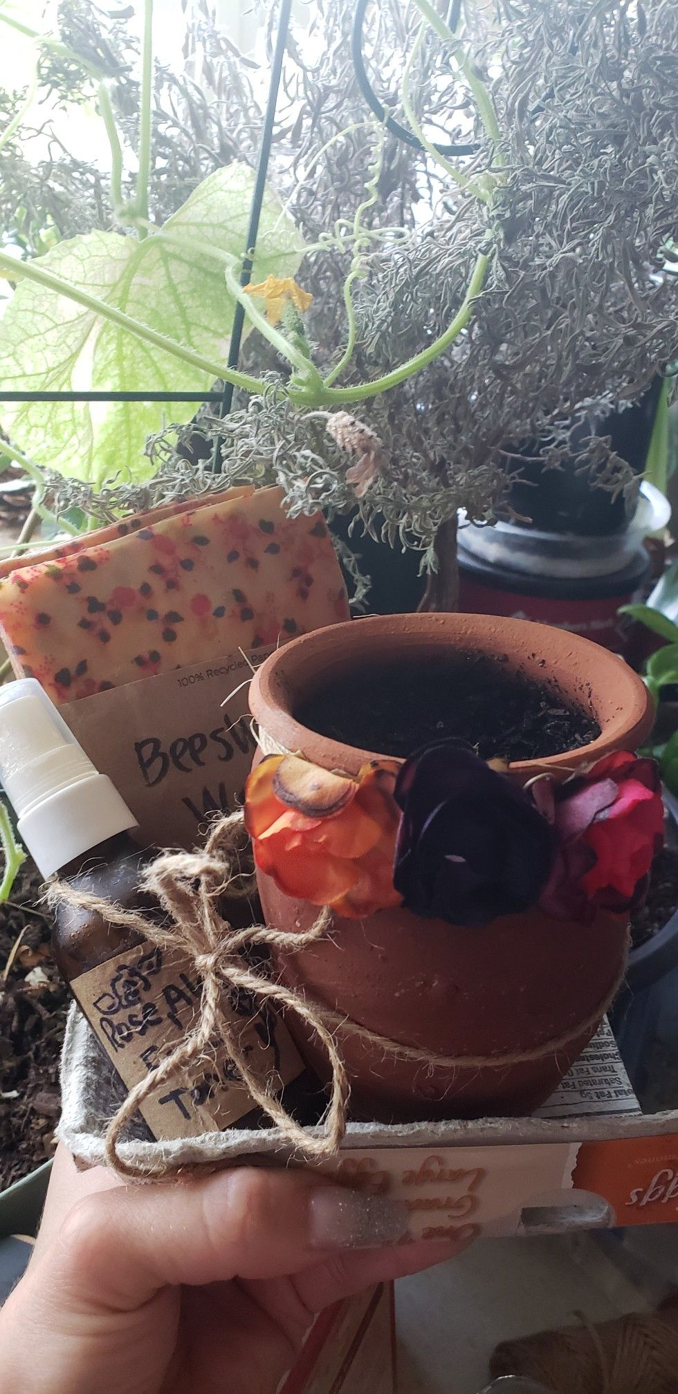 Homemade green gift box with diy rose water and aloe face