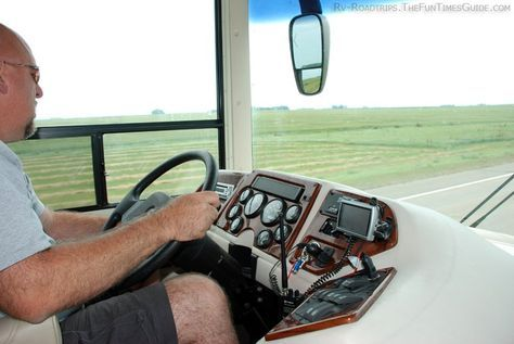 Jim adjusting the seat, steering wheel, and mirrors in our RV.