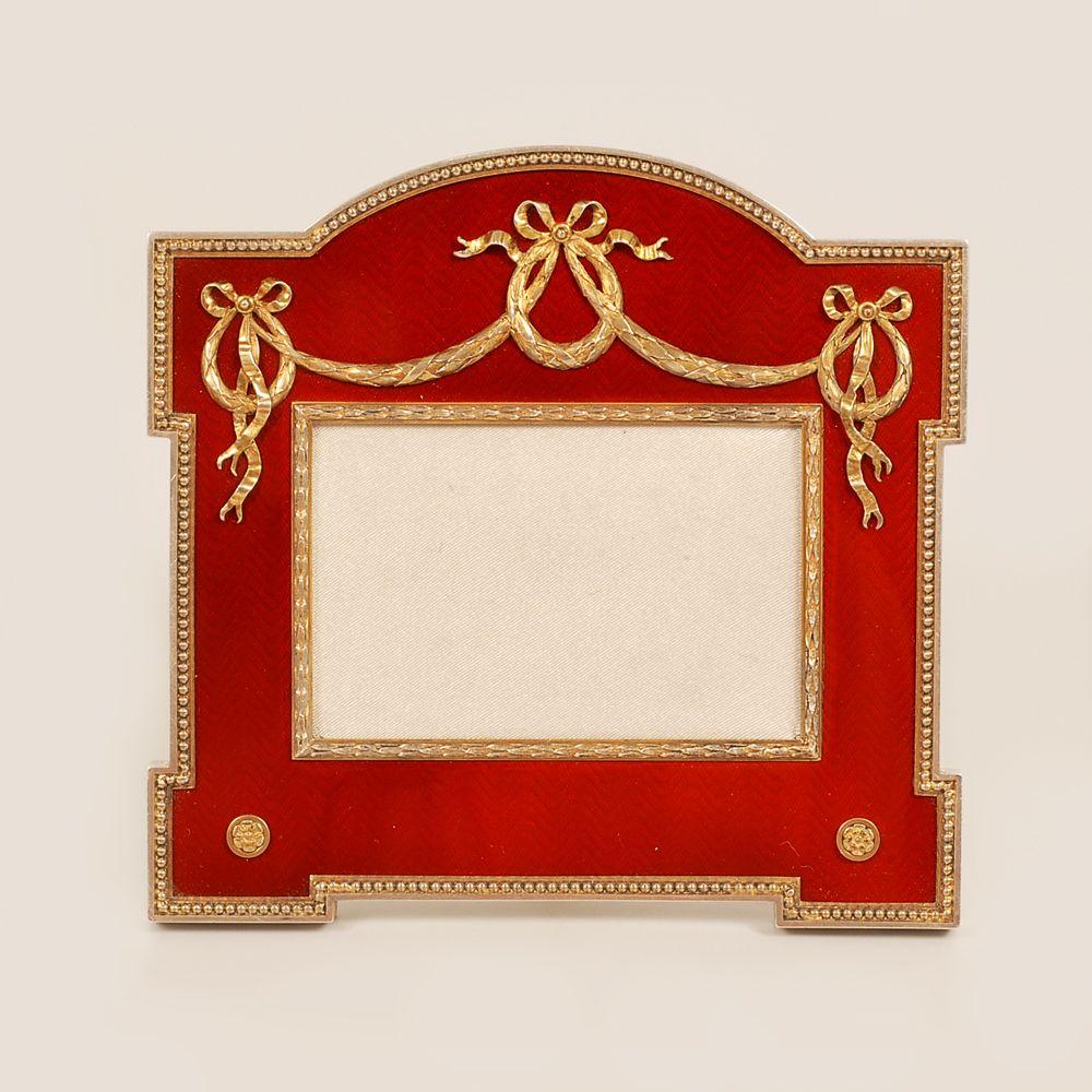 A Faberge silver gilt and enamel photograph frame, Karl Gustaf ...
