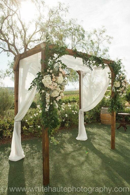 Intense Stunning Arch With Greenery Fabric