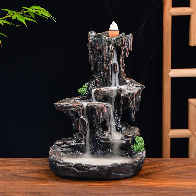 Infuse your air with the vitality of nature and enhance your well being with handcrafted The Old Hill Fall Aromatic Waterfall. Smoky waterfall diffuse aroma that can dissipate negative energy, purifies the air and gives you relief from daily stress. Features - Our ceramic backflow incense burner is an elegantly designed and beautifully crafted collection that offers you a Zen, peaceful and relaxing aromatherapy experience. You can light our reverse incense burner at your Home, Office, Living Roo
