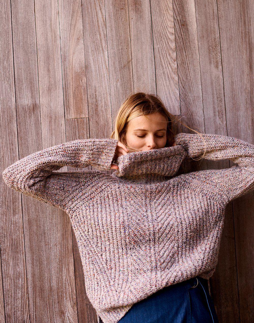 fbd50d93f6 madewell colorfleck turtleneck sweater worn with denim raw-hem mini wrap  skirt.