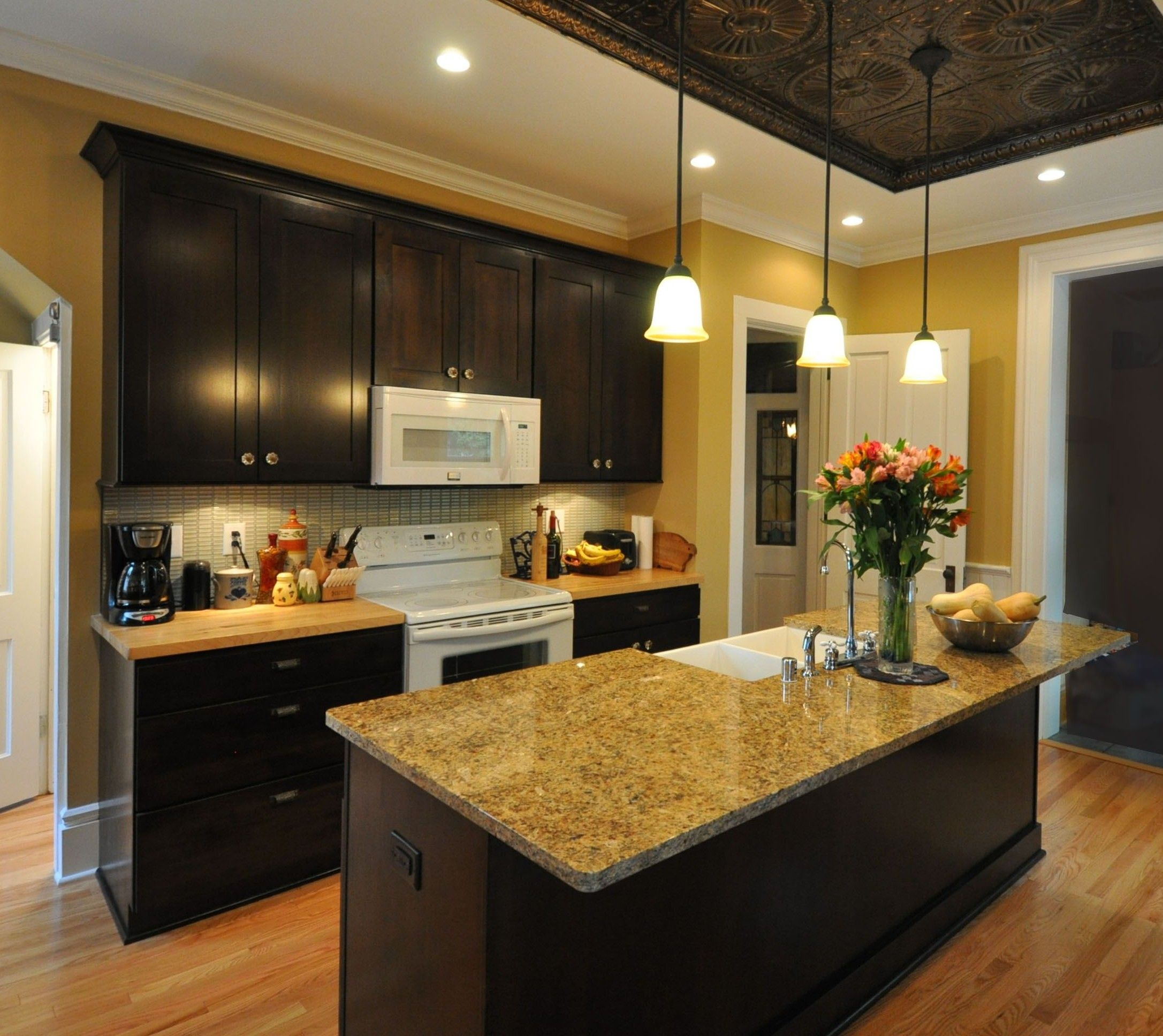 Brown Kitchen Cabinets: Countryside Cabinets Dark Brown Cabinets, Tan Granite, And