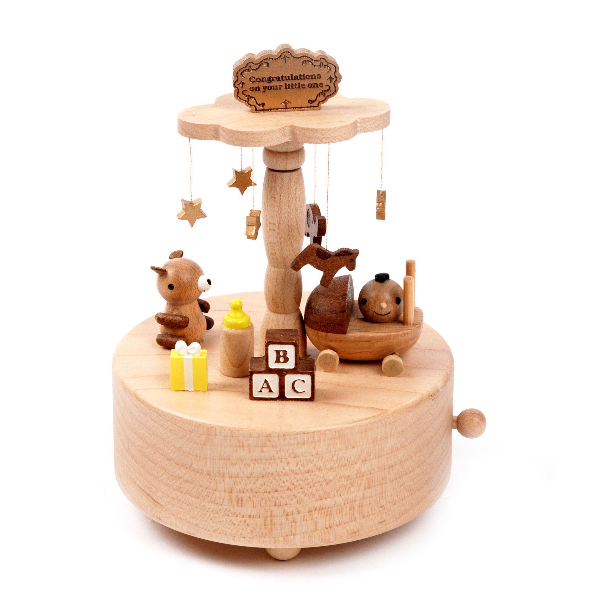 Newborn baby play with unicorn wooden music box music