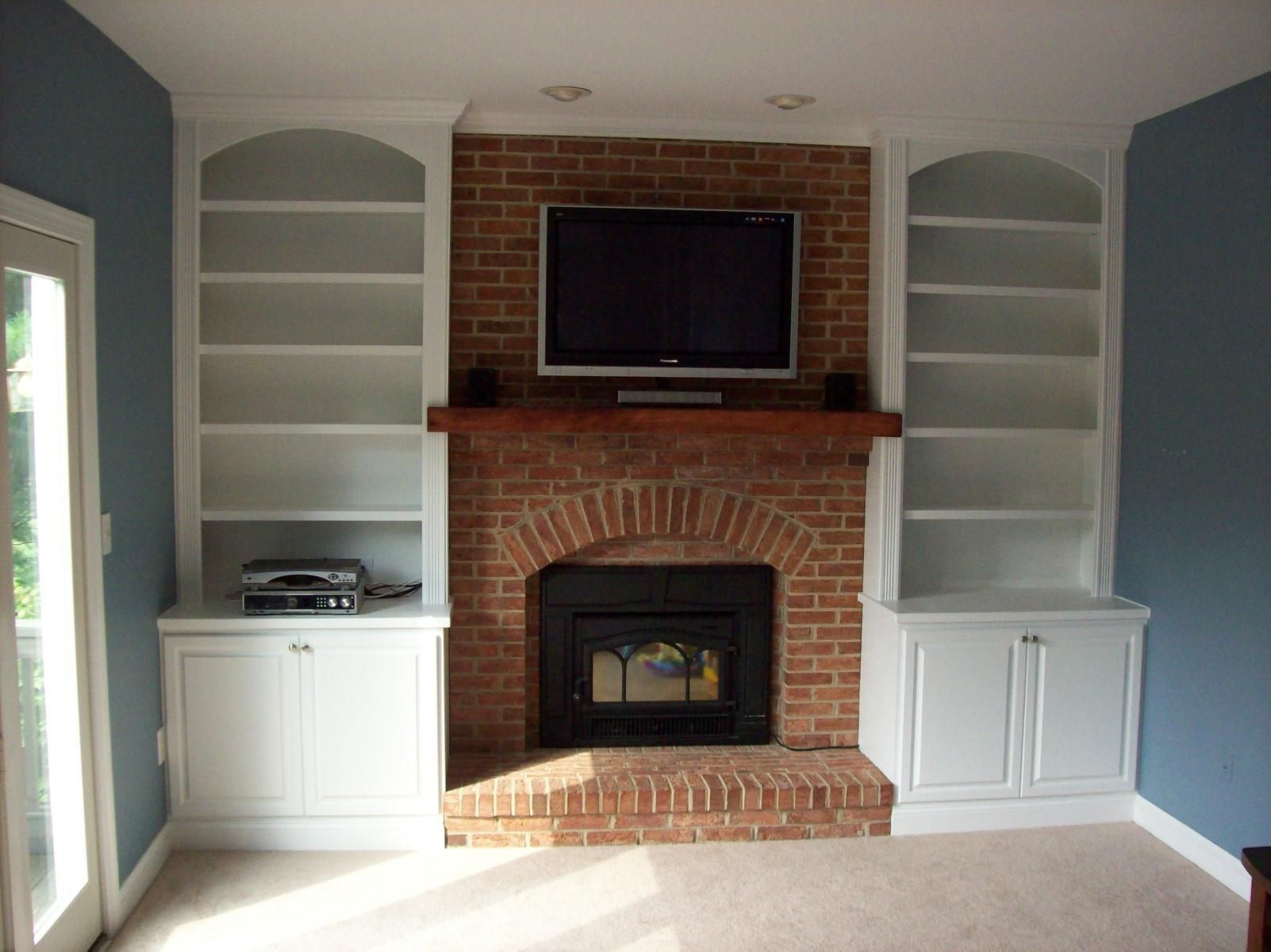 Fireplace bookcase on pinterest bookshelves around fireplace shelv - Interior Sweet Brown Wooden Floating Fireplace Shelves For Lcd Place And Brick Wall Exposed Panels As Well As White Oak Wood Open Shelved B