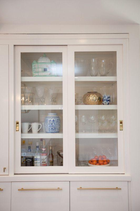 A Kitchen Makeover Modern Fresh And White Glass Cabinet Doors Sliding Glass Door Kitchen Door Handles