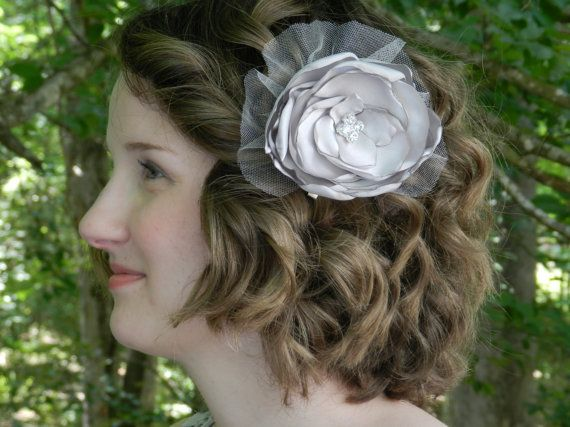 Pewter satin hair flower clip with a vintage style rhinestone button center and shimmery netting.