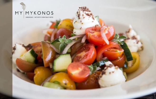 Try our modern twist on the classic Greek salad, made with local, fresh cherry tomatoes! #MyMykonosHotel #healthyliving #bohoismystyle #mykonos#bohostyle #luxuryboutique #mykonosluxury #vacationmode #fashion #styleblogger #greekislands #chillmode #vacationgoals #greekfood #yummy #saladgoals #tasty #healthyeats