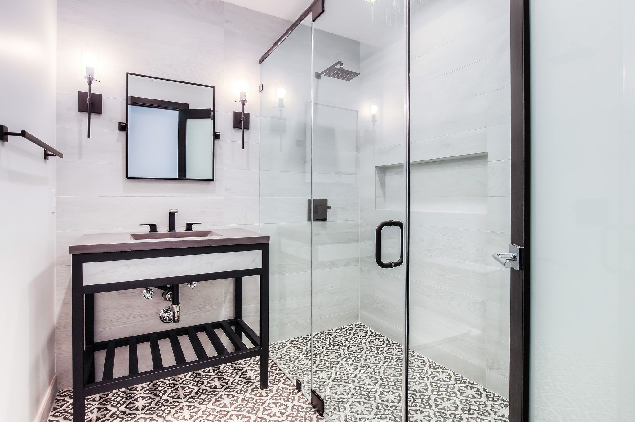 Modern guest bathroom with cement ties, frameless shower and wood ...