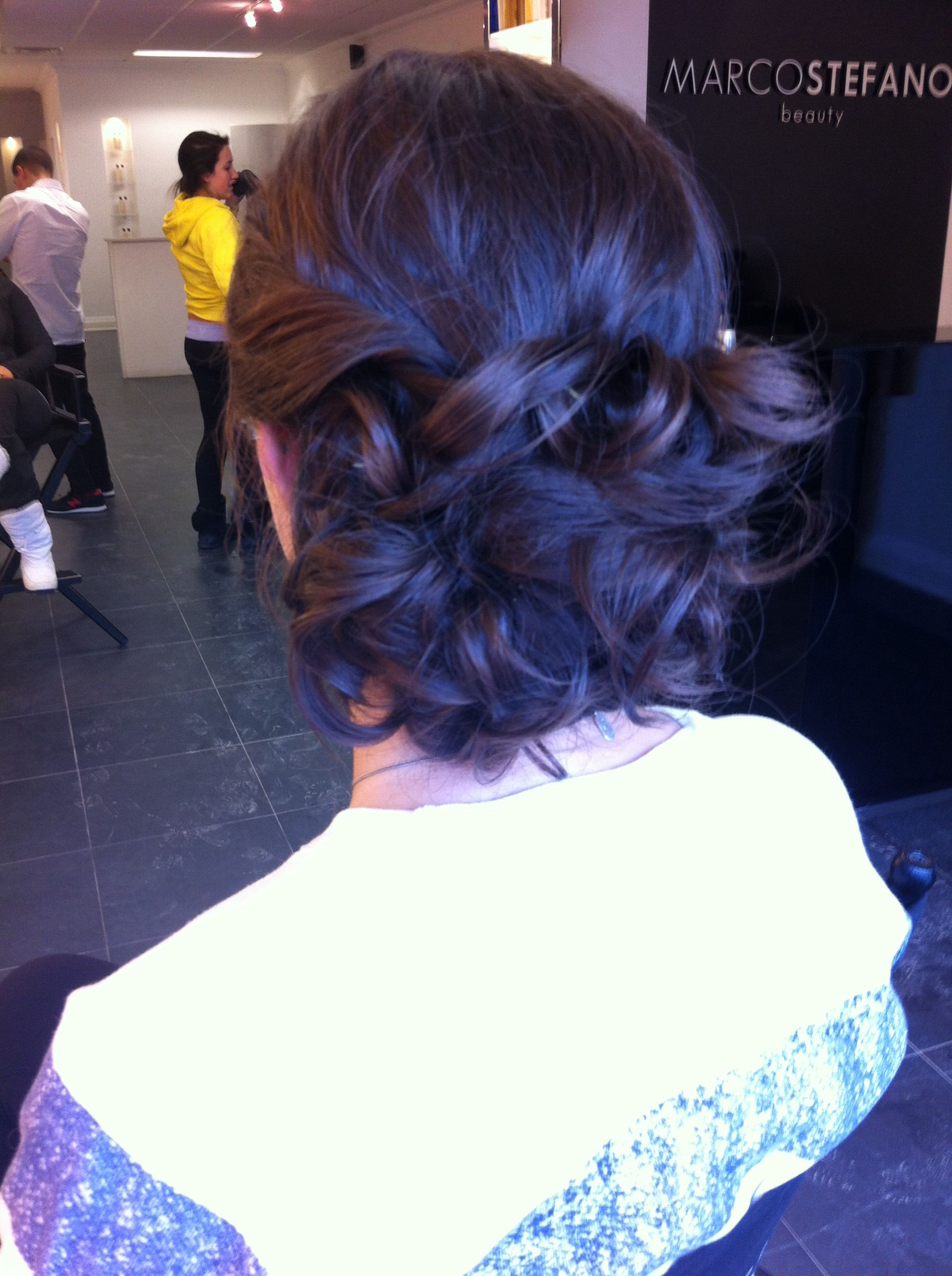 Updo for a semiformal gorgeous loose low bun with a ton of texture