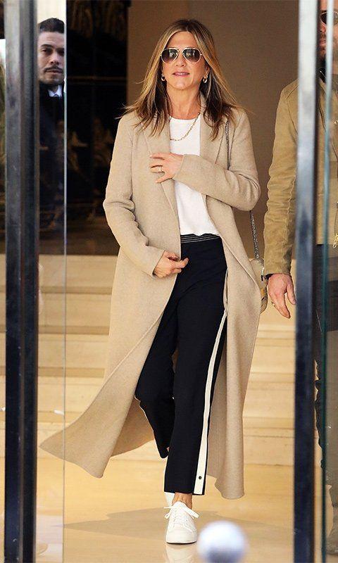 b78570b0a62 Jennifer Aniston in a Beige Coat and Black Track Pants
