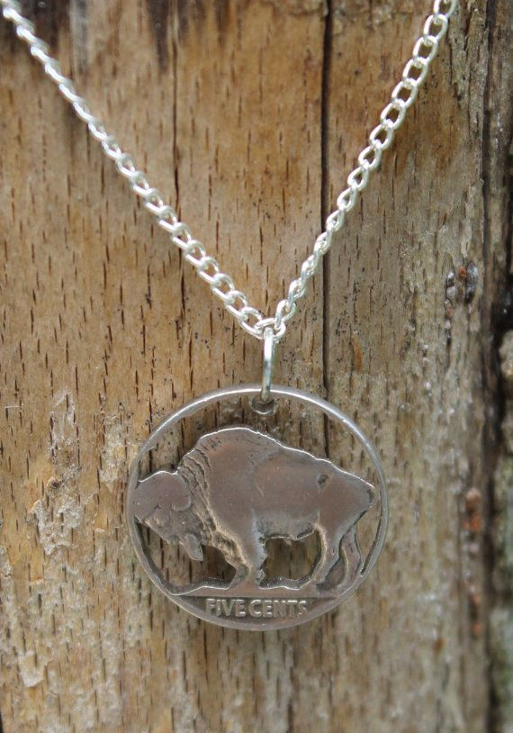 This beautiful, hand cut reverse of the Buffalo Nickel (minted between 1913-1938) comes as a pendant with or without a silver bezel. It can also come with 5 cents cut out from under the buffalo. It would make a great gift for anyone that likes unique jewelry.  Please note that due to the fact each coin is genuine and hand cut, there may be some variation from the picture. If you have a special coin that you are looking for, please do not hesitate to contact me as I love to do custom too.