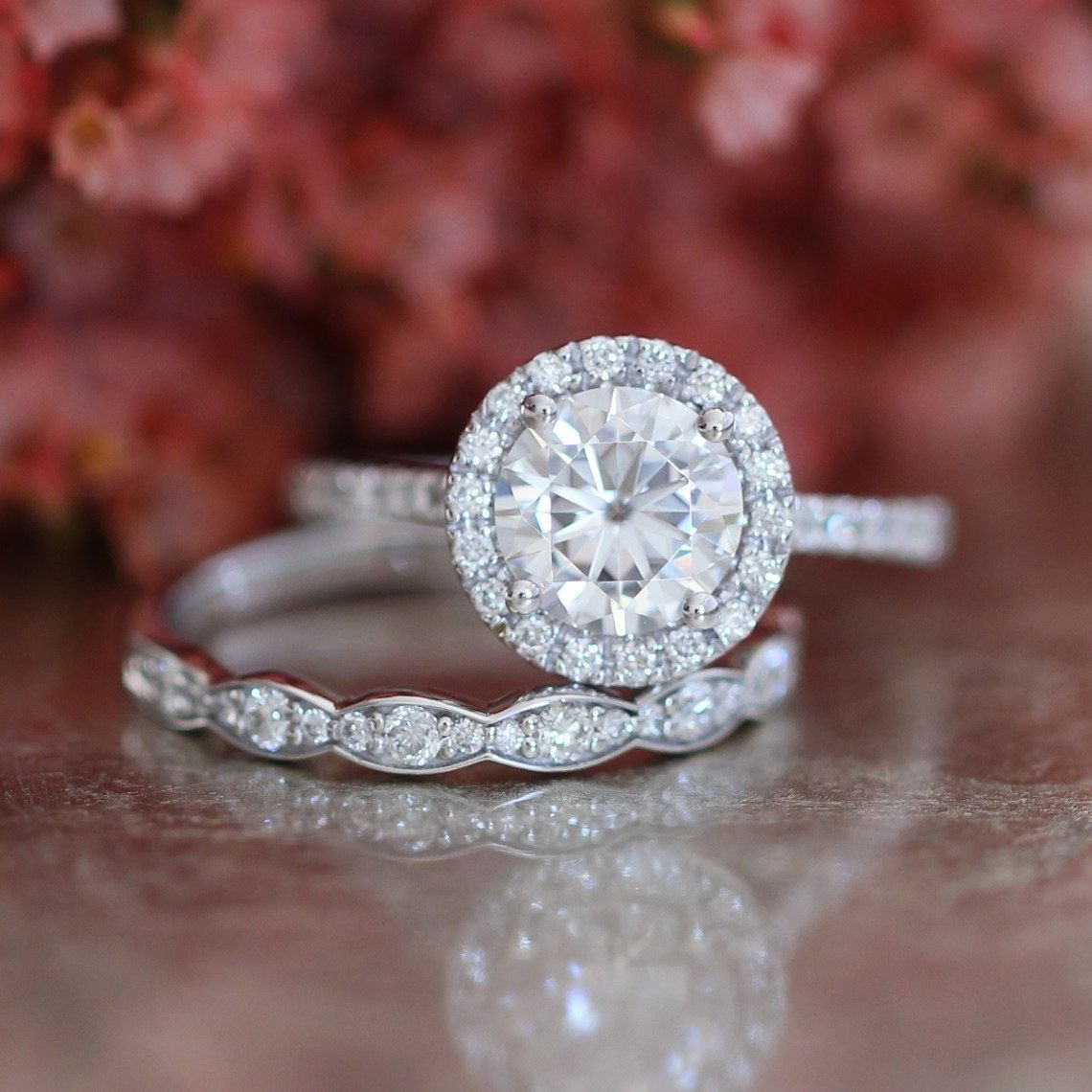 This bridal wedding ring set showcases a mm round cut certified