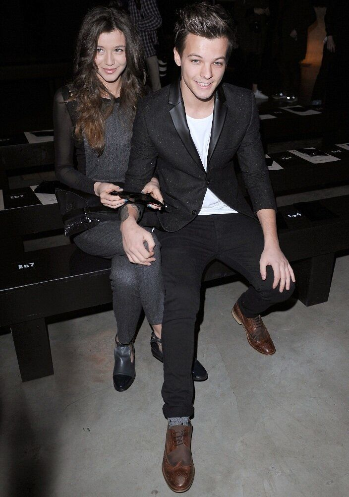 Louis Tomlinson and Eleanor Calder (The way he has his hands on her knee and she's really into him <3)