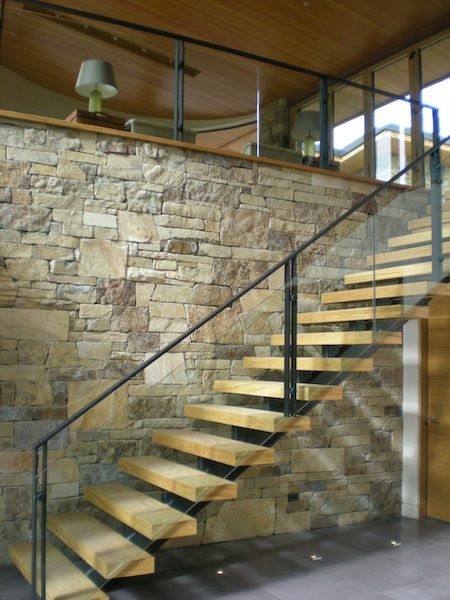 Wood Stair, Glass And Metal Railing And Stone Wall