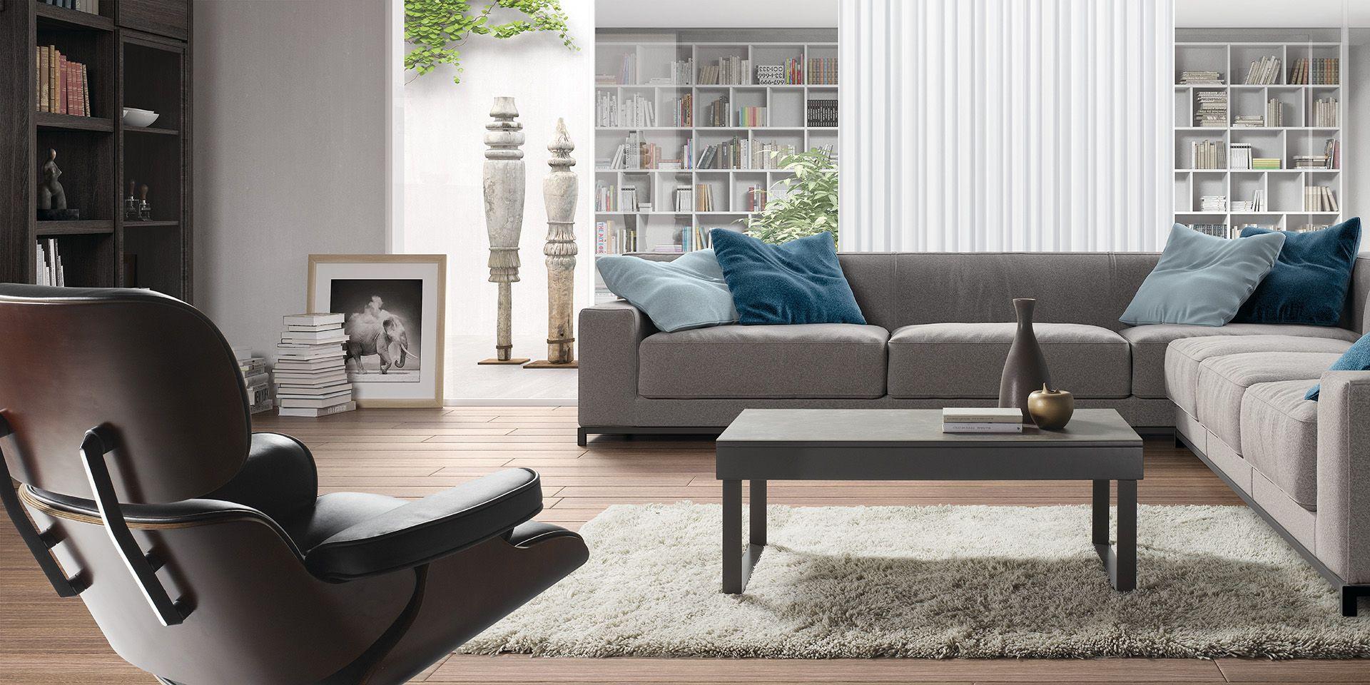 Interior de estilo moderno. Sillon y reposapiés junto a sofá ...