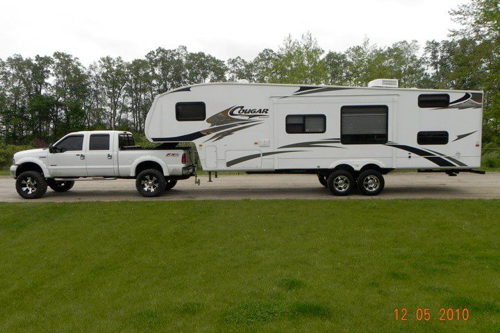 Lifted White Ford F 250 Power Stroke Diesel Towing Fifth Wheel