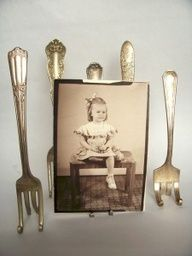 Silver Fork Easels.  Saw one and just had to make one.  I did not have to look far for an extra silver fork, I have several.  I saw a number of different designs on how to bend the tines.  The one you use depends on the photo, frame or item you want to display.  So easy, so cute!