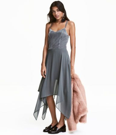 Dark gray. Sleeveless chiffon dress with velour front section. Narrow, double shoulder straps crossed at back, concealed side zip, and flared skirt with