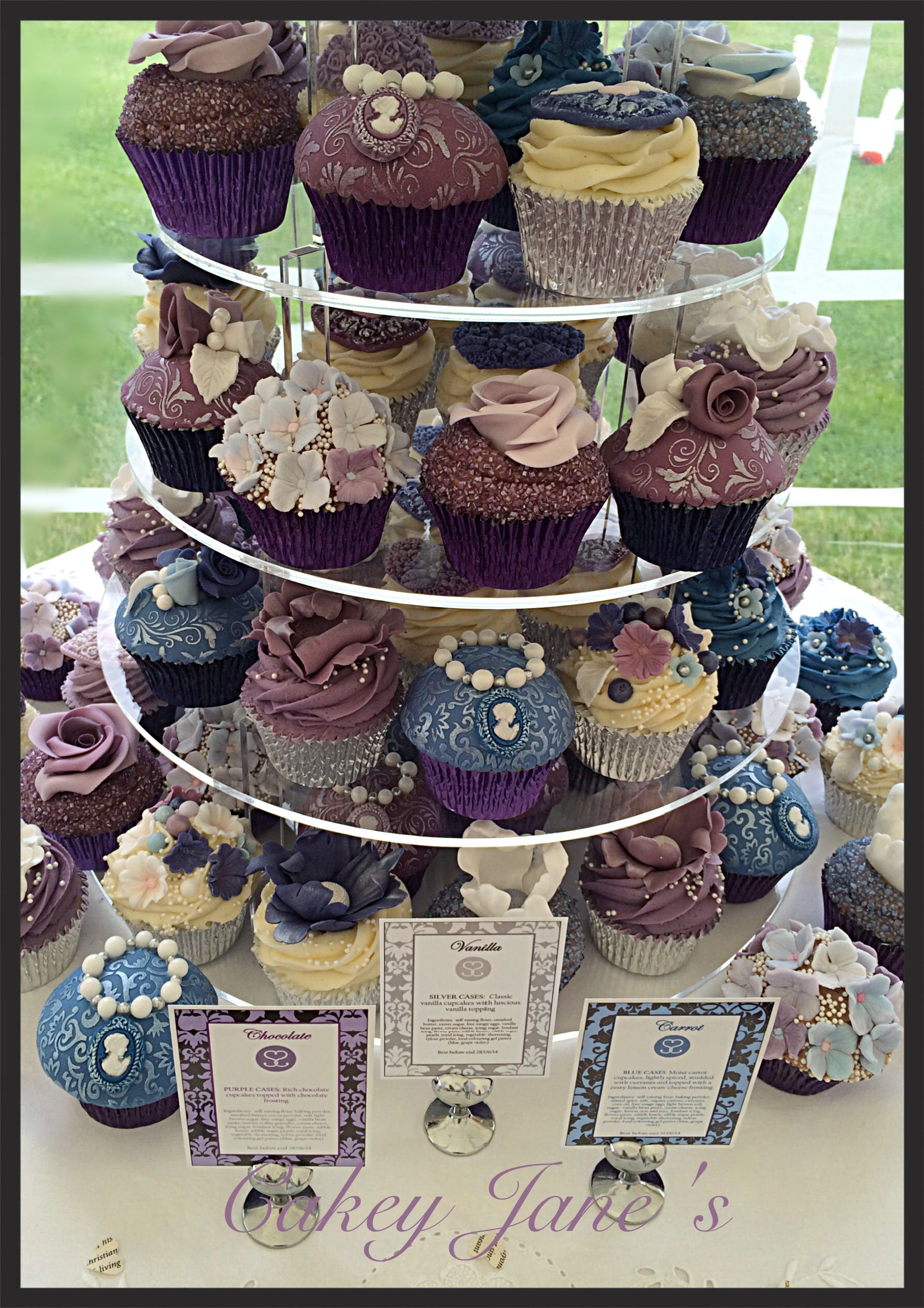 Blue themed wedding decor  Vintagethemed wedding cupcake tower purple blue and silver theme