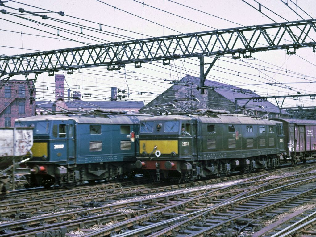 E26002 and E26031 (later 76031) at Guide Bridge on 13th July 1967. E26031 was built at the Metro-Vickers Gorton Works and delivered on 19th June 1952. Withdrawn on 20th July 1981 and cut up at Coopers Metals, Sheffield on 28th April 1984, becoming the last of the class to be cut up, only E26020 survives.
