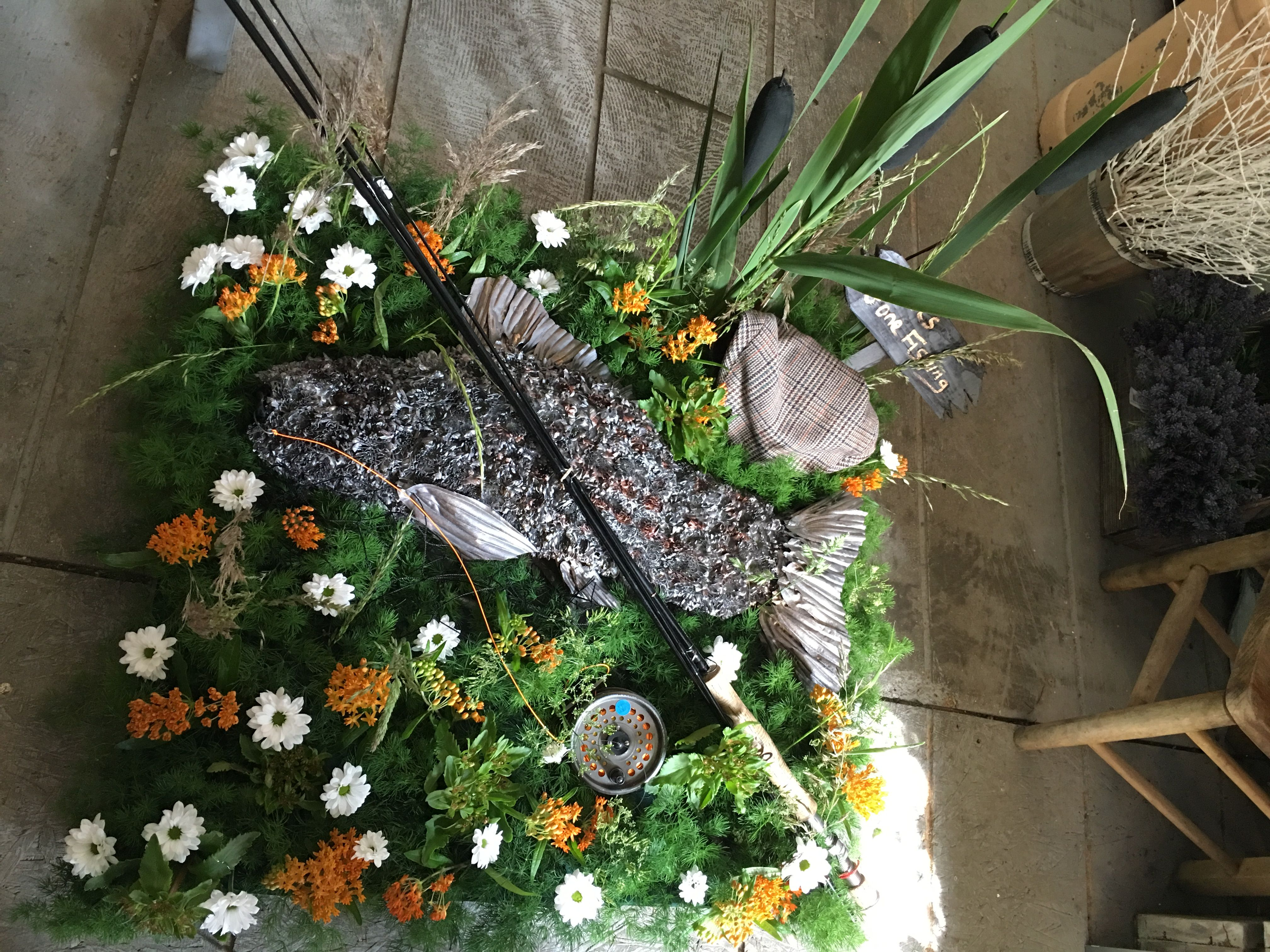 Funeral flowersfish on the river bed with reeds and flowers funeral flowersfish on the river bed with reeds and flowers fishing rod dhlflorist Choice Image